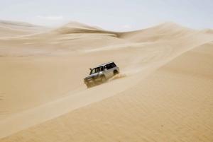From 4x4 Desert Safari with Sandboarding & Camel Ride