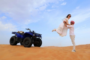 Dubai: Red Dune Bike Tour with Camel Ride and Barbecue