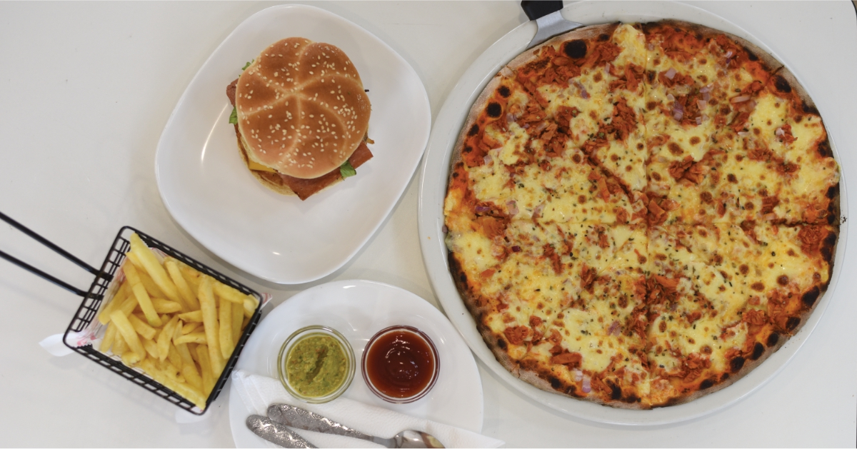 Buy any Large Pizza Receive a FREE Burger at Pizza & Burger Perfect
