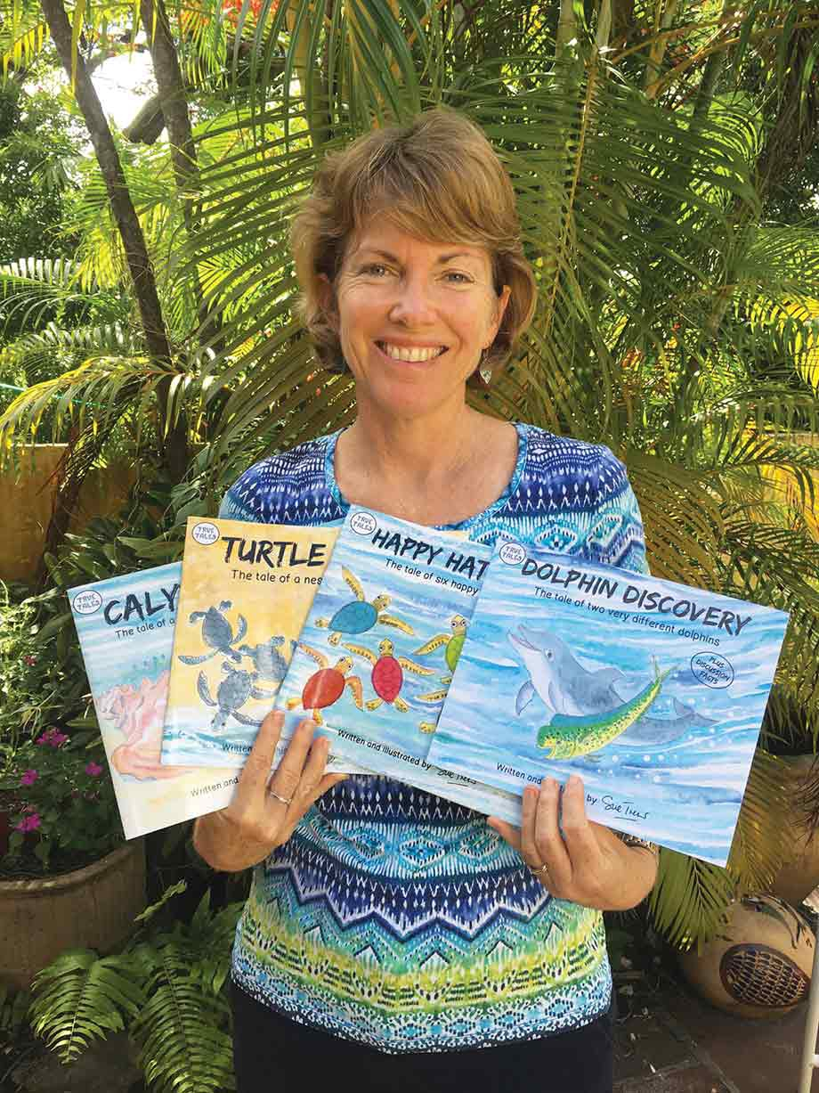 Sue Trew displaying her series of children's books
