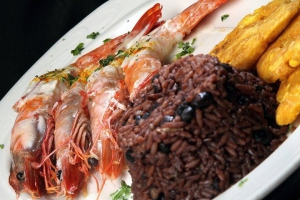 Prawns in meuniere sauce with tostones, cuban rice and black beans