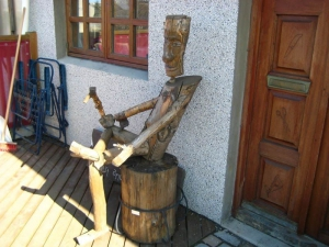 A carving outside of the workshop