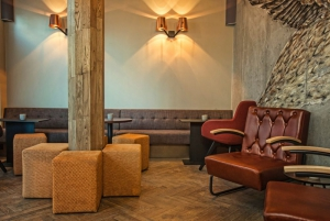 Leather couches in the Lounge at Kol Restaurant