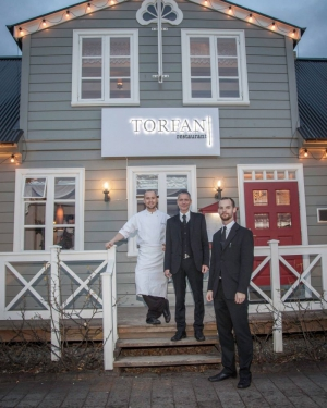 A proud Head Chef, Manager and Maitre D' outside Restaurant Torfan in Reykjavík