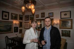 A couple in a tastefully decorated room in Torfan Restaurant, Reykjavík