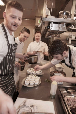 There's always time for some fun in the bustling kitchen of Torfan Restaurant